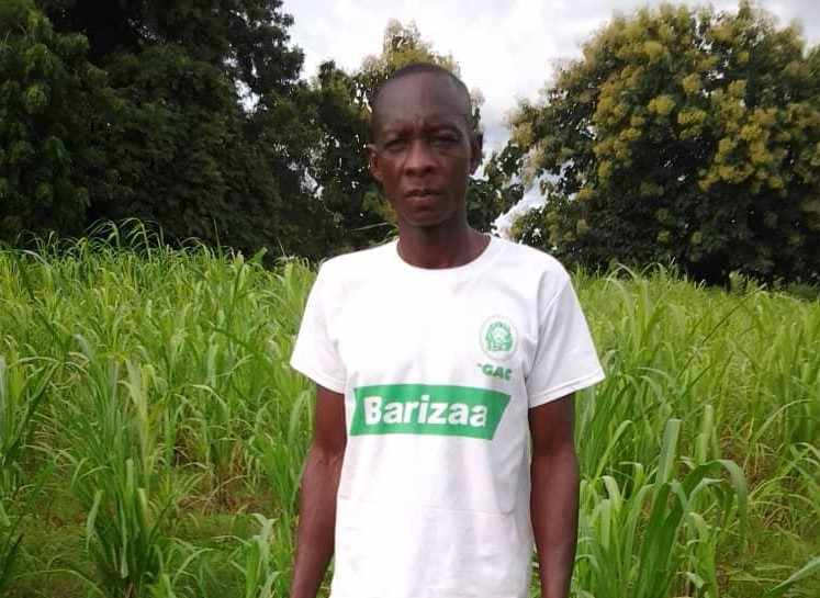 Mr Justin Kubati Bania on His farm land - Copy
